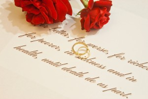 Wedding rings, vows and roses